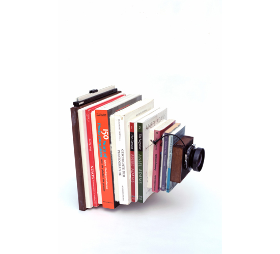 Taiyo Onorato & Nico Krebs, <em>Book Cam 4</em>, 2013. Books, wood, 8 × 10 sheet holder, lens, pedestal. Courtesy RaebervonStenglin, Berlin, and Peter Lav, Copenhagen.